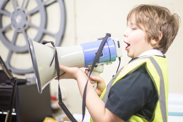 Young person blaring through a loudspeaker